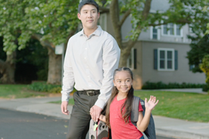 OTS Go Safely Video Still Of Father And Daughter Holding Hands While Crossing Residential Street